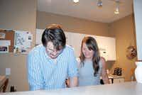 Haley Marcum and Philip Johnston work together in the kitchen of their downtown Plano apartment. Marcum said they looked at several Plano apartment locations before settling in downtown.(Staff photos by JULISSA TREVIÑO - neighborsgo)