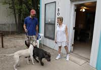 Carol Merritt (right) talks to Jon Tomell, one of her clients, as he picks up his two dogs at Boykin Kennel in West Oak Cliff. Her kennel is one of the oldest in Dallas.(David Woo - Staff Photographer)