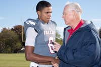 Bishop Dunne quarterback Caleb Evans gets advice from Jeff Williamson of the Bishop Dunne class of 1965 before a TAPPS high school football playoff game Nov. 21 against Tomball Concordia Lutheran.( Photo submitted by GLORIA NIETO )
