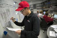 Volunteer Albert Yao works in the Team Rubicon Mobile Command Center.(G.J. McCarthy - Staff Photographer)