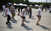 People dance during the First Annual Teen Pride event in Dallas, Saturday, Sept. 14, 2013.