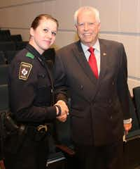 Mayor of Mesquite John Monaco (right) congratulates Nicole Shire on March 7 the Mesquite Police after graduating from the city's new internal police academy.(Photo submitted by WAYNE LARSON)