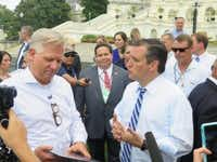 Sen. Ted Cruz speaks with conservative Glenn Beck during the anti-Iran deal rally at the U.S. Capitol on Wednesday. Behind them is Rep. Blake Farenthold, R-Corpus Christi. (staff/Todd J. Gillman)