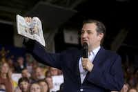 Sen. Ted Cruz holds a copy of USA Today as he tells a campaign rally in Knightstown, Ind., on April 26, 2016, that the news media is biased for Donald Trump. (Andrew Spear/The New York Times)