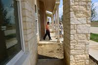 Coppell ISD assistant superintendent Sid Grant tours a multi-family apartment, which is part of Dallas-based developer Billingsley Co.'s Cypress Waters mixed-use development.