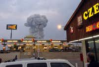 People at the Czech Stop in West, Texas watched a cloud of smoke rise Wednesday from an explosion at a fertilizer plant.