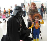 """Little ones can see Darth Vader and hear music from """"Star Wars,"""" """"Harry Potter,"""" """"Jaws"""" and """"The Flintstones"""" at Spooky Symphony with Plano Symphony Orchestra Oct. 27."""