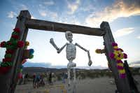 A makeshift skeleton dangles from one of the entrances to the Terlingua Ghost Town cemetery on the eve of Nov. 2, where townspeople gather each year to decorate the graves of dead loved ones. The annual ritual includes dinner and music furnished by residents of the tiny Big Bend community.( Robert W. Hart  -  Special Contributor )