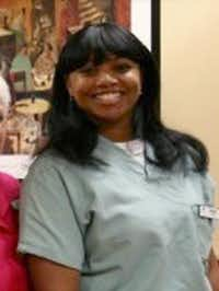 This 2011 photo provided by Dr. Barry Weiss, from the website of Advanced Periodontics in Hamden, Conn., shows former employee Miriam Carey. The 34-year-old Carey was shot to death by police after a car chase that began when she tried to breach a barrier at the White House.