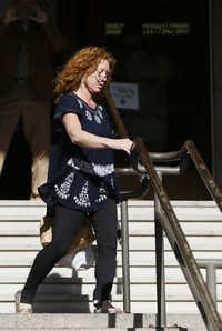 Wearing an electronic GPS monitor on her left ankle, Tonya Couch left the courthouse after a hearing in Fort Worth in January. (Brandon Wade/The Associated Press)
