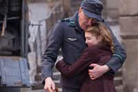 Liesel (Sophie Nélisse) and her foster father Hans (Geoffrey Rush) share a quiet moment in The Book Thief