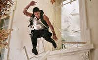 """Channing Tatum as  Cale, a Capitol policeman who springs into action to save his child and protect the president from a heavily armed group of paramilitary invaders in Columbia Pictures' """"White House Down."""""""