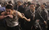 """Channing Tatum, left, stars as  Cale, a Capitol policeman who springs into action to save his child and protect the president (Jamie Foxx) from a heavily armed group of paramilitary invaders in Columbia Pictures' """"White House Down."""""""