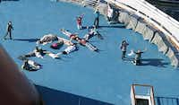 """Passengers spelled out """"HELP"""" as the Triumph was towed to harbor.Gerald Herbert - AP"""
