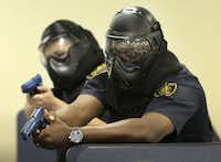 Dallas ISD officers Luis Armendariz (left) and Lawrence Strange took part in active shooter drills last week.