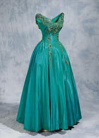 """This satin teal gown embellished with sequins and rhinestones is included in """"Made Especially for You by Willie Kay.""""(North Carolina Museum of History - AP)"""