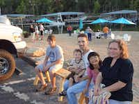 During a 2011 vacation in Missouri, Keith Helms is joined by his children, Joshua (left), Noah and Molly Helms, as well as his wife, Jennifer Smiley.Photo submitted by JENNIFER SMILEY