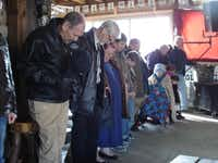 A few dozen church members gathered on a recent cold Sunday morning to pray with one another during a service at Narrow Trail Cowboy Church.Staff photo by JULISSA TREVIÑO