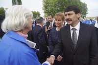 Magda Bader and Hungarian President Janos Ader at Auschwitz in April 2014.( Naomi Martin  )