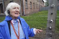 Magda Bader takes an audio tour at Auschwitz in April 2014.( Naomi Martin  )