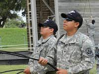 Samuell High School JROTC cadet major Roy Moreno (right), and Skyline High School cadet major Emanuel Perez manage rope while helping belay fellow Dallas ISD cadets rappel down a wall at Camp Bullis.(Photo submitted by EDWIN DUMAS)