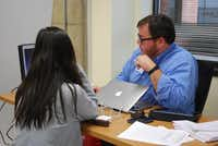 Kenneth Dunkle, a 10th grade teacher at Academy High School, works with a student during classtime.Staff photo by JULISSA TREVIÑO