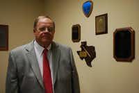 Bill Bell, who has served two full terms as Rockwall County judge, chose not to run again in 2006 to care for his ailing mother.(Staff photo by ANDREW SCOGGIN)