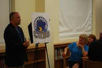 Billie Stevenson Elementary Principal Mike Pitcher debuts the school's new mascot, which is modeled after the old Fate School's cub mascot.(Meredith Shamburger - Neighborsgo)