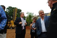 From left: Flower Mound Town Manager Jimmy Stathatos, Assistant Town Manager Debra Wallace and developer Mehrdad Moayedi await the beginning of a groundbreaking ceremony Aug. 13 at the River Walk at Central Park development. Moayedi's company, Centurion American, recently purchased the undeveloped land for the project.