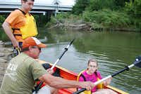 Greta (left) and Matthew Wise of Coppell receive instruction from Trinity River Kayak Company staffer David Cannon before venturing down the Trinty River near Hebron Parkway.