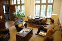 The Rev. Paul Rasmussen (left) chats with Joe Park in his office at Highland Park United Methodist Church. He officially took over the role of senior pastor last July from the Rev. Mark Craig, who led the church for 18 years.(ANDREW SCOGGIN - neighborsgo staff)
