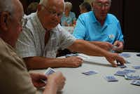 From left, Mike Copliano, Denis Toth and Tom Goad play Hand and Foot, a variant of canasta, at the Shirley Voirin Social Senior Center in Flower Mound.
