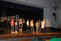 J.L. Long Middle School choir students practice their roles during a dress rehearsal of Super Rock on May 13. Hirsch, the choir's director, is retiring after 28 years at the school.(Staff photo by ANANDA BOARDMAN - neighborsgo)
