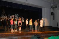 J.L. Long Middle School choir students practice their roles during a dress rehearsal of Super Rock on May 13. Hirsch, the choir's director, is retiring after 28 years at the school.Staff photo by ANANDA BOARDMAN - neighborsgo