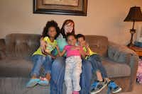 Kimmy (back center), 28, has lived at Emily's Place in Plano with her three children since November. The facility offers women housing, counseling and assistance during a 24-month period.Staff photo by NANETTE LIGHT - neighborsgo