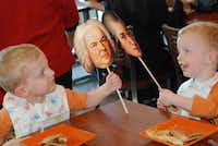 Twins Jack and Justin Rollins play with their friends, Bach and Mozart.( Photo submitted by TAMMY MEINERSHAGEN )