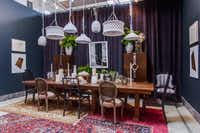 Swoon, the studio Layered rugs, mismatched chairs and an array of white light fixtures induce inspiration for a one-of-a-kind dining room.Lance Selgo  -  Unique Exposure Photography