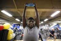 LaWanda Williams works out with other city employees at the Dallas City Hall Fitness Center. City officials are hoping to boost participation in wellness and disease-management programs.( Nathan Hunsinger  -  Staff Photographer )
