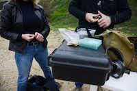 Dallas Pistol Club members Kerry Shulman and Wayne Dobbs load a round of bullets at the range.(Rose Baca - neighborsgo staff photographer)