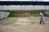 Dallas Pistol Club member Javier Criado shoots a round at the club's private outdoor range in Carrollton.(Rose Baca - neighborsgo staff photographer)