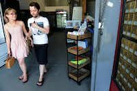 Alexis Clare and Andrew Strickland walk out of the Deep Ellum Postal and Grocer after purchasing a record. The space has been the Deep Ellum Postal Center for a number of years, but a bodega-style neighborhood market has been added to the shop's offerings.