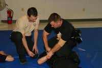 Mesquite Instructor Clint Crabtree works with recruit Richard Andersen during the police department's new internal basic training course.( Photo submitted by BRIAN PARRISH  )