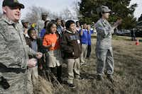 Students from nearby Sidney Lanier Elementary School and members of the Texas National Guard cheered Thursday as soldiers demolished an abandoned house used for illegal drug activity. The house at 1234 Flanders in West Dallas was the first of about 20 structures that will be demolished as part of the Texas Joint Counterdrug Task Force's Operation Crackdown.