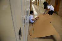 Students Alejandro Arteaga and Daniela Gonzalez work on creating a cardboard rocking chair for their Destination Imagination team's anti-smoking campaign at Bryan Adams High School.(Rose Baca - neighborsgo staff photographer)