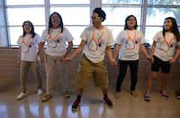 Students practice the skit for their team's anti-smoking campaign.(Rose Baca - neighborsgo staff photographer)