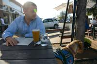 Dustin Deweerd stops to grab a drink at Oddfellows with his 3-year-old Labrador service dog Gunny on March 20, 2014 in Dallas. Gunny helps Deweerd, a U.S. Army veteran, cope with his Post Traumatic Stress Syndrome after serving in Irag and Afghanistan for two years.Rose Baca - neighborsgo staff photographer