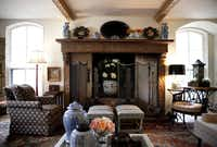 The hand-carved mantlel shows off the fireplace in the living room.