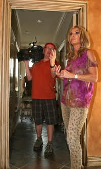 "Cameraman Scott Wilson discusses a scene with Donna Moss during the filming of the HGTV reality show ""Donna Decorates Dallas."""