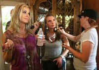 """Makeup artist Cheslea Lee (right) applies makeup to Ashley Moss during a break in the filming of """"Donna Decorates Dallas."""" Host Donna Moss is on the left."""