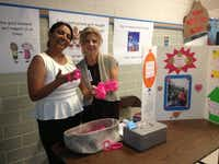 Dover campus reading specialist Hannia Vincenti and executive assistant Sheila Baxter sold memorial braclets in honor of Stephanie Calams at a recent PTA meeting.